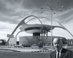 Paul Williams, the first African-American member of the American Institute of Architects (AIA), in front of the Theme Building at LAX, of which he was a designer.