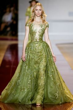 "Zuhair Murad Couture. Getting anxiety at the thought of the New Hot Color - Chartreuse? I'm here for you! ""Chartreuse"" can be Anything from Nearly Yellow to Deepest Peridot. This Gown Is Peridot, Embellished. It has a Fitted Bodice and a Lavish Skirt. Your Jewels are also Peridot, Total Embellishment and they, too, are Lavish. Add Soft Metallic Sandals and a Taupe Velvet Bag. Swirl on a Taupe Velvet Cape on your way out (It's all on this board). We can get you through anything. - Gabrielle"