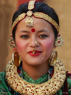 Newary woman with a set of traditional gold jewelry. Nepal