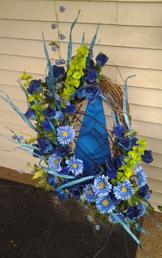 Black Baccara Designs is a Full Service Florist. We offer custom wedding and event designs. Custom home decor and special ocassion flowers. Corsage And Boutonniere, Football Themes, Grapevine Wreath, Blue Flowers, Funeral, Event Design, Grape Vines, Custom Homes, Floral Design