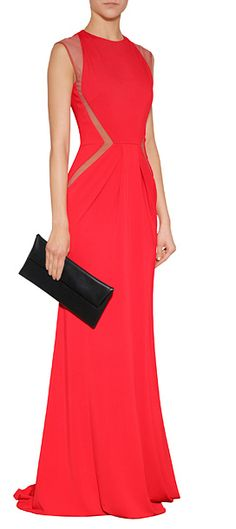 Elegant with a contemporary twist, this floor-grazing evening gown from Elie Saab features sultry sheer paneling and a stunning scarlet hue #Stylebop