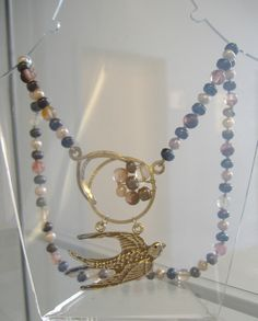 Sterling silver cast swallow on sterling silver focal clasp set with cherry quartz and freshwater pearls