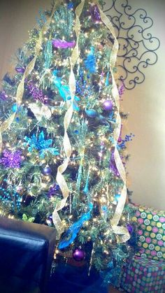 my peacock christmas tree from last year i got most of the ornaments from hobby lobby