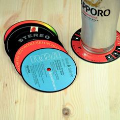 Protect your tables with a bit of nostalgia. These neat record label coasters are made from recycled vintage LP records and then laminated. The set Cool Coasters, Drink Coasters, Creative Gifts, Unique Gifts, Old Cds, Incredible Gifts, Home Upgrades, Coaster Furniture, Tea Accessories