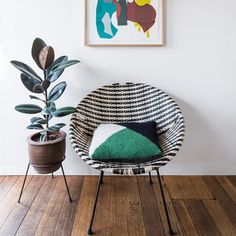 Chic chair, graphic cushion and wall art  | The Lifestyle Edit