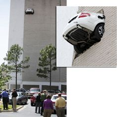 A Mercedes hangs from the 7th floor parking garage at the Bank of America in Oklahoma. The car backed through the wall after the driver's foot stuck on the accelerator. Debris rained down to a parking lot below, damaging several cars. No injuries were reported.