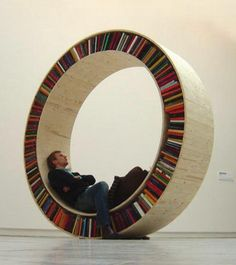 rolling bookcase :) if it had a comfy seat in the middle it would be sold!