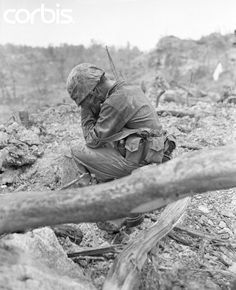 """Weary and exhausted after the tough battle for Hill 200 Near Peleliu Airpoet, this Leatherneck sits down amidst the battle rubble and weeps. According to latest reports, the Marines are making steady progress on the Island, although heavy fighting continues."" (Original caption) 26 Sep 1944 Peleliu. #WWII #USMC #History ©Bettman/Corbis Images"