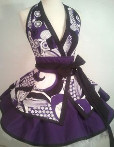 Keiko likes to flirt with old Japanese traditions, like the kimono, but add some flair. So our Geisha Girl SassyFras Character apron features