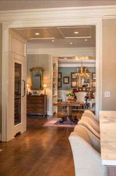 Traditional Home with Timeless InteriorsA view of the dining room (similar paint color: Benjamin Moore Buxton Blue towards the kitchen. Hardwood floors are white oak, quarter sawn in planks 11 inches wide. - Home Decor Style At Home, Hardwood Floor Colors, Hardwood Floors, Wood Flooring, Estilo Interior, Luxury Interior Design, Interior Colors, Traditional House, Traditional Decorating