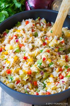 Caribbean Confetti Rice - a fragrant coconut rice recipe loaded with chiles, sweet peppers, pineapple, cilantro, and spices. Easy to make and so delicious.