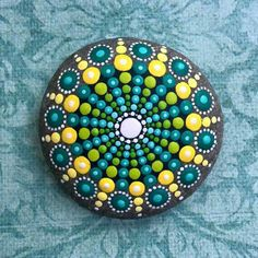 Yellow green teal mandala stone