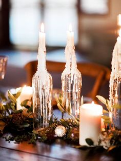 Beautiful table runner idea for a winter wedding. You could even make these wine bottle candles yourself!