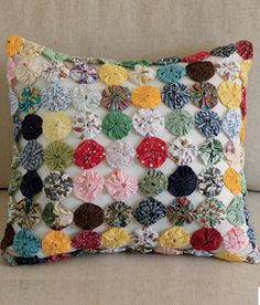 Yo-Yo Pillow, from Country Curtains. $45.50 I so need to make one of these!!!!!