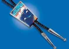 """""""GRAND TETONS BOLO TIE by Jesse Monongye, of turquoise, coral, ironwood, lapis lazuli, dolomite, silver, fourteen karat gold; 1998. Private collection. Photograph by Kiyoshi Togashi. Courtesy of Lois Sherr Dubin.""""  Bolo Ties: Contemporary Neckwear of the West, by Diana F. Pardue, Ornament, issue 35.4"""