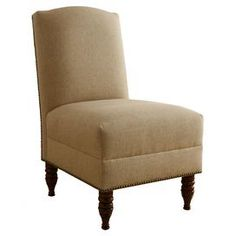Nailhead-trimmed slipper chair with pine wood frame. Handmade in the USA.   Product: Chair  Construction Material: Solid pine, wood, linen polyurethane foam and polyester fill   Color: Sandstone   Features:     Nailhead trim  Turned feet  Handmade in the USA Sumptuous cushioning          Dimensions: 35.5 H x 22 W x 30 D       Cleaning and Care: Spot clean only