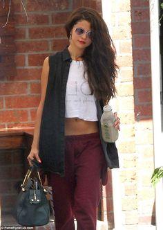 Retro beauty: Selena rocks the 1980s look as she stops by a dance class in LA