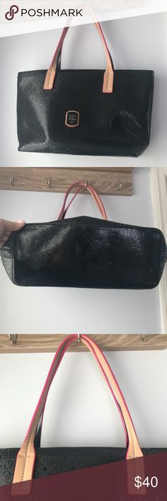 Guess Black Leather Bag NWOT Pretty black shoulder bag with pink accents from Guess.  Was a gift that I never used.  Has some light scuffs (picture included) from being stored on the floor of my closet.  Otherwise like new. Guess Bags Shoulder Bags