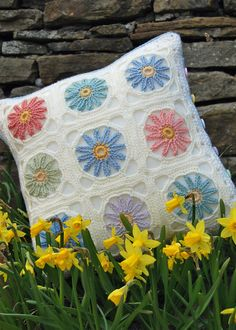 This cushion cover was inspired by the thought of spring being just around the corner but you can make it for any season - just have fun playing with colours! There is no specified tension, yarn weight or hook size for this pattern - you can make it from any yarn - just use a hook to fit the yarn :) The cushion is made from 18 squares, 9 with flowers and 9 in Granny Square design, finished with a simple border and fastened with buttons (again, your choice). The stitches used are chain…