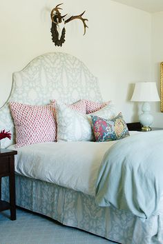 """Sneak Peek: Caitlin Wilson Design's Oregon Project. """"Playful patterns combine to create every guest's dream slumber sanctuary. Walls are in Benjamin Moore White Swan, lamp is Robert Abbey, bed is Schumacher Chenonceau in Aquamarine and pillows are in Schumacher Chain Link in Cerise."""" #sneakpeek"""