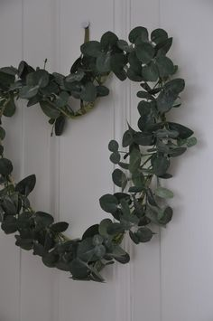 wreath, in my bathroom, with tiny purple and white flowers