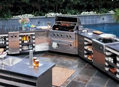Love outdoor kitchens this is great for a guy who wants to entertain his bros outside away from the women lol