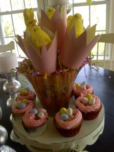 Easter arrangement:  -paper cups  -peeps  -rods (to hold the peeps)  First, cut the cup in a broken egg shape. Next, puncture the cup with the rod, and then press the peep into the stick. Voila! The perfect Easter centerpiece!