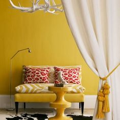Yellow living room with animal patterns and elk horn art.