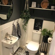 Add a touch of elegance to your tiny cloakroom by painting the walls dark grey. Contrast with simple white tiles for a spacious and contemporary look. Bathroom Under Stairs, Man Bathroom, Big Bathrooms, Upstairs Bathrooms, Bathroom Ideas, Clockroom Toilet, Grey Toilet, Toilet Tiles, Small Downstairs Toilet