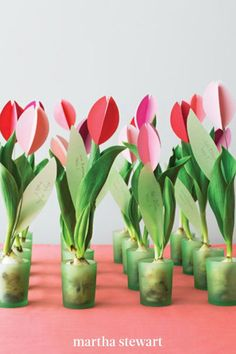 We placed tulip bulbs in candleholders with enough water to cover the roots, then added paper blooms. Download our templates for the flower petals and the rest of the paper tulip tutorial. #marthastewart #crafts #diyideas #easycrafts #tutorials #hobby