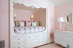 An Interesting Bedroom Decor With Carved Built In White Wooden Bed With Many Drawers Underneath And Colorful Cushions Also White Wooden Classic Cabinet Cute Pink Children's Room, a Fairy Tale for Princesses Bedroom design