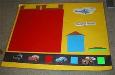"""Decimal Street: place value fun even for preschoolars.  See also her blog entry """"Adapting Math-U-See for the pre-primer crowd ."""""""