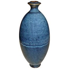 Daniel de Montmollin, Ovoid Vase | Ovoid stoneware vase, enameled decoration based on a hay ash with the dominant colors of blue and light blue. Extremely complex art work and virtuosic experiment for this potter. It stays on a small base.