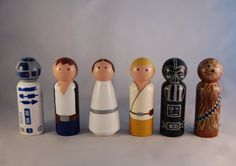 Hand Painted Star Wars Peg Doll Set. Includes 6 peg dolls R2D2, Han Solo, Princess Leia, Luke Skywalker, Darth Vadar, & Chewbacca. Each peg measure 3