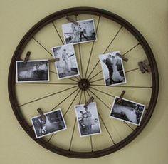 Old bike wheel turned photo display!