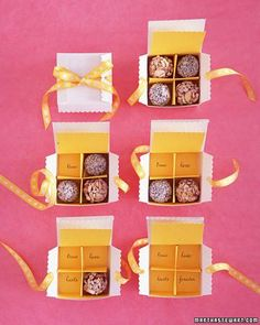 A secret message hidden beneath coconut-and-cashew truffles is revealed as the chocolates are devoured. The packaging seems fancy, yet this is just a standard box trimmed with scalloping scissors. The tabs are usually tucked in, but we left them out, punched holes, and threaded ribbon through for a unique form.