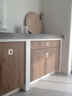 Wood and concrete kitchen. Love the handles
