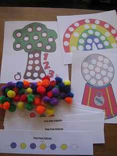 These are printable magnet pages. You can find these at Making Learning Fun.  She got colored puff balls and glued little magnet pieces on the back.  These you can use on a small cookie sheet or a magnet board.