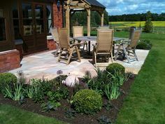 Re-designed and enlarged main patio to provide plenty of room for relaxation, dining & soaking up the sun - with clear views of the children's play area.