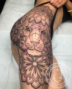 Lion tattoo hip tribal mandala