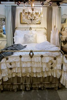 LoVe Chandelier B*L*I*N*G over a bed... and curtains on the wall as headboard!