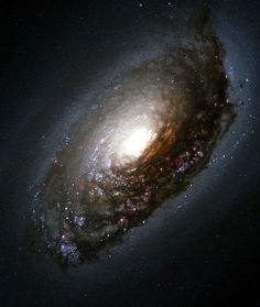 "The ""Black Eye"" galaxy, so named because an ancient cosmic smashup produced a…"