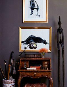 Gabriel Hendifar vignette, burlwood desk, black/white art in gold frames, bulb task lamp, African statue