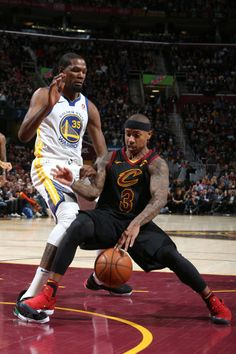 Isaiah Thomas of the Cleveland Cavaliers handles the ball during the game against Kevin Durant of the Golden State Warriors on January 15 2018 at...