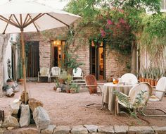 A tranquil, graveled courtyard garden, furnished with a collection of rusting chairs and decorated with an ornamental fountain, is the ideal place to while away a warm summer's night.