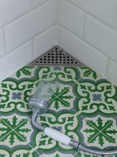 Bathroom floor with Marrocan tiles and corner drain