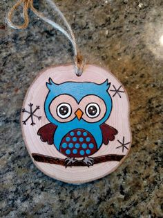 Owl wood burned ornament. This ornament is made out of wood gathered from fallen limbs on our (and our extended familys) property. No trees are cut down to make my ornaments. Painted portions of this ornament are sealed with a matte finish. I can personalize this ornament with a