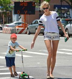 Leggy supermodel Karolina Kurkova shows she's a child a heart as she wheels around on son Tobin's scooter Celebs, Celebrities, Supermodels, Sons, Running, Children, Style, Fashion, Young Children