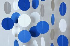 Celebrate with this blue and white paper garland, perfect for a graduation reception or birthday party!    It is made from cardstock circles,
