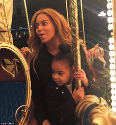 Fun at the fair! Beyonce is seen riding a carousel with her daughter in another set of pho...